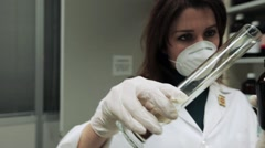 Pharmacist woman makes a chemical compound in the laboratory. Stock Footage