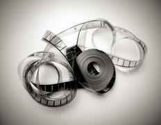 Unrolled 35mm movie reel in vintage black and white Stock Photos
