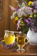 Medicinal herbs, honey, herbal tea Stock Photos