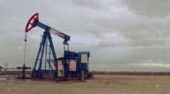 Pumpjack Oil Pump operating on natural gas Stock Footage