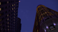 NY-building streetlamp night pan - stock footage