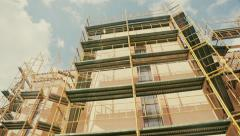 Church under construction renovation scaffording in urban area Stock Footage