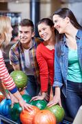 Happy friends in bowling club Stock Photos