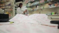 Medical prescriptions, pharmacist on background out of focus - stock footage