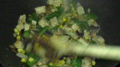 Frying Quorn tikka Stock Footage