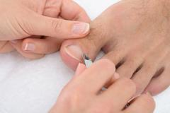Close-up Of A Beautician Trimming Cuticles Clipper Stock Photos