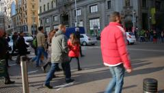 Pedestrians Crossing Intersection On Busy Road In Central Madrid Stock Footage