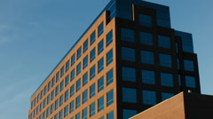 ESTABLISHING SHOT OF OFFICE BUILDING EXTERIOR / TILT UP . MODERN. Stock Footage