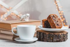 Objects on sackcloth bank and cookies with nuts and chocolate cake Stock Photos