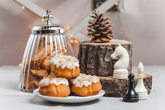 Objects on sackcloth bank and cookies with nuts and cupcake and chess Stock Photos