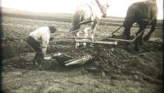 904 - digging dirt with horses pulling wheelbarrow - vintage film home movie - stock footage