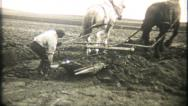 Stock Video Footage of 904 - digging dirt with horses pulling wheelbarrow - vintage film home movie
