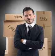 Businessman fired from job - stock photo