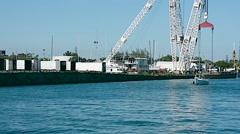Sailboat motoring on lake Port 01CUsv1v - stock footage