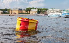 Anchor buoy at the Neva river in Saint-Petersburg, Russia - stock photo