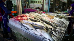 Fresh fish table display at market Stock Footage