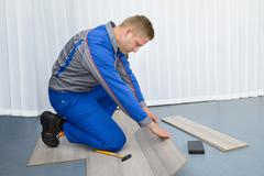Portrait Of A Worker Assembling New Laminate Floor Stock Photos