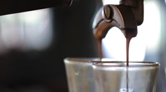 Espresso pouring from machine Stock Footage