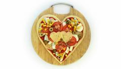 Valentine vegetarian pizza - pizza in the shape of heart Stock Footage