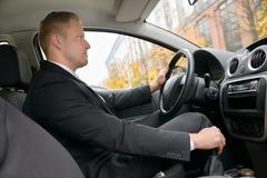 Young Man Changing Gear While Driving A Car Stock Photos