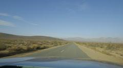 California desert high speed driving down long winding road Stock Footage