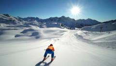 Skier in downhill position on empty ski piste Stock Footage