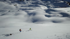 two skiers off piste in powder snow - stock footage