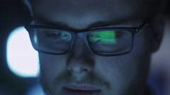 Computer Screen Reflection in Programmer's Glasses Evening Stock Footage
