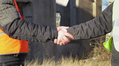Two engineer's hands grip in greeted - stock footage