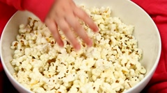 Taking pop-corns Stock Footage