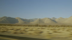 Driving through California desert Pinewood to Ridgecrest with mountains Stock Footage