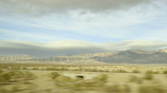 Driving through California desert natural wind energy Stock Footage