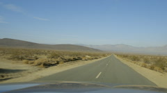 California desert driving down long road Arkistovideo
