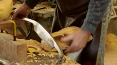 Clog maker cutting of the edges of a clog Stock Footage