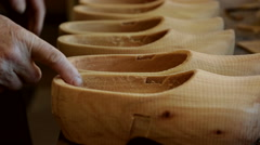 Clogs waiting to be painted Stock Footage