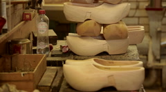 Clogs stacked on top of each other Stock Footage