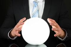 Close-up Of Businessman Hand On Crystal Ball - stock photo