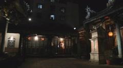 Dalongdong Baoan Temple - pan shot at night Stock Footage