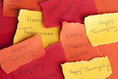 Many Memos with the Handwritten Words Happy Thanksgiving on it - stock photo
