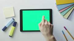 Using Tablet with Green Screen on Designer's Table Stock Footage