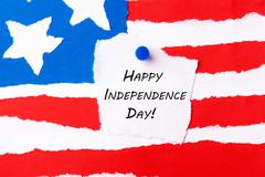 American Flag Background with Happy Independence Day Notice aon it Stock Photos