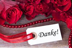 A Background with Roses and the German Word Danke which Means Thanks - stock photo