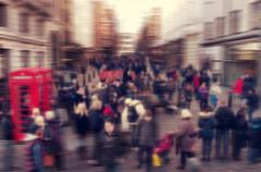 defocused blur background of people walking in a street in London, UK - stock photo