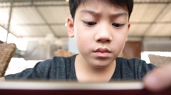 Angry asian boy playing game on your mobile phone-8 Stock Footage