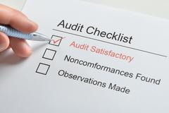 Person Hand Make Tick On Audit Satisfactory In Audit Checklist Paper Stock Photos