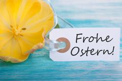 Banner with the German Words Frohe Ostern which means Happy Easter - stock photo
