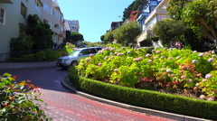Cars drive down Lombard Street in San Francisco, America's windiest street. Stock Footage