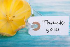 Banner with Thank You on turquoisen Wood with Yellow Tulip Blossom - stock photo