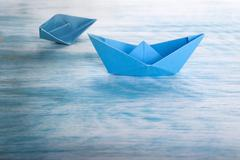 Boat Accident with Origami Boats, Symbolical Background Stock Photos