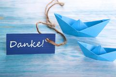 Label with the German Word Danke which means Thanks and Boats in the Backgrou - stock photo